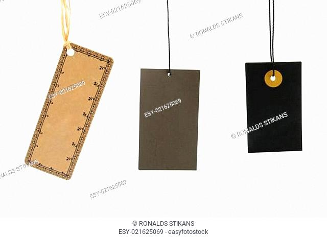 Blank cardboard tags hanging on white background