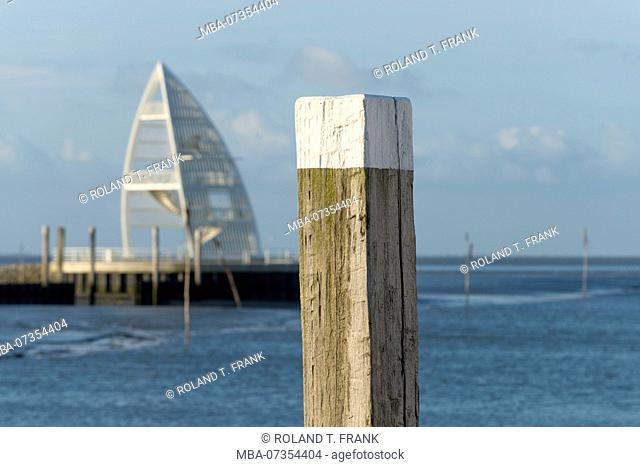 Germany, Lower Saxony, East Frisia, Juist, wooden bollard at the harbor