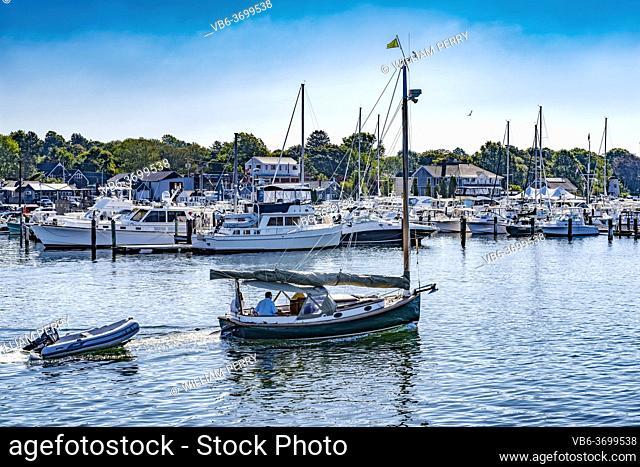 Goiing Out to Sea Catboat Sailboats Yacht Club Piers Docks Padanaram Harbor Buzzards Bay Dartmouth Massachusetts. .