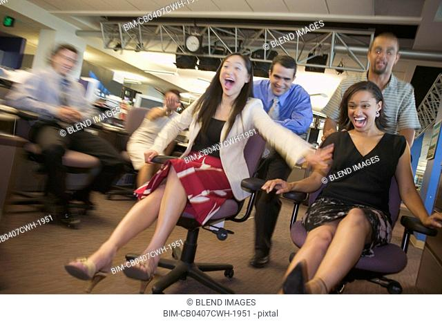 Businesspeople relay racing in office