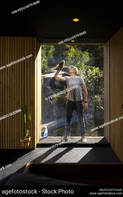 Window view through with window cleaner. Pavilion House, Guimarães, Portugal. Architect: Diogo Aguiar Studio, 2019