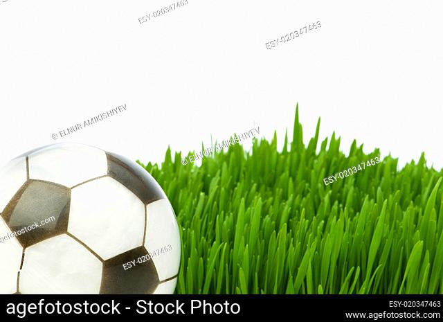 Sport concept - football on the green glass
