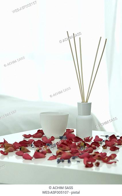 Aroma sticks with lavender flowers and rose petals on table, close up