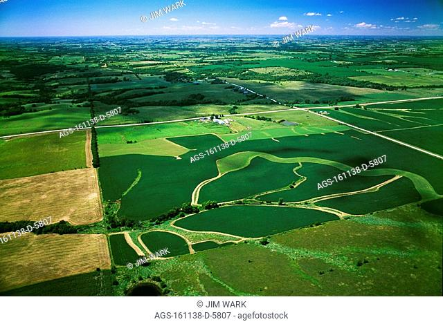Agriculture - Aerial view of rolling agricultural land, the foreground field shows grassy waterways that drain rainwater from the field / IA - nr