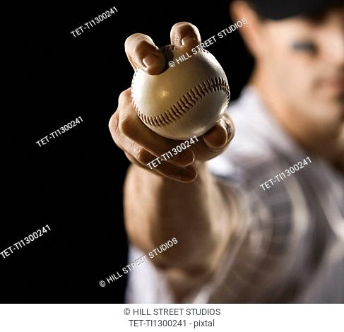 Close up of pitcher holding baseball