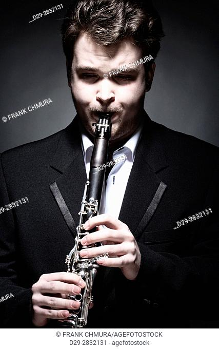 Portrait of Young Male Musician Playing Clarinet