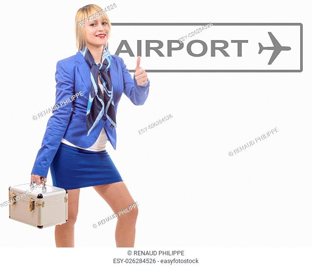 pretty blonde stewardess in blue suit with a small suitcase, isolated on white