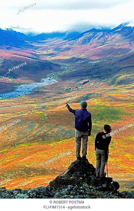 Hikers Overlooking the Tombstone Valley in Autumn, Dempster Highway, Yukon