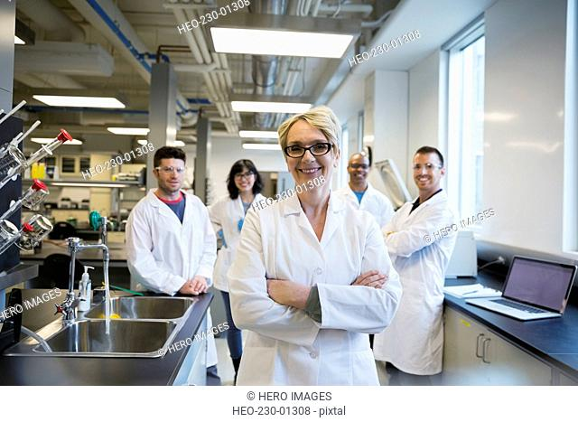 Portrait smiling scientists in laboratory