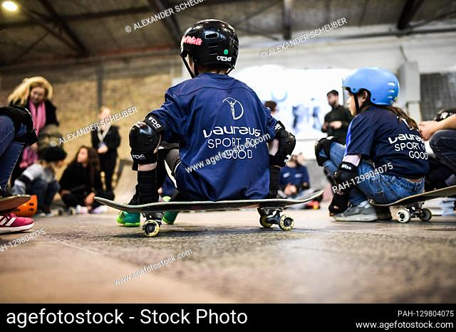 Children sit on a skateboard. Laureus Sport for Good Skateboarding Event. GES / Laureus World Sports Awards 2020, Berlin, February 16, 2020 | usage worldwide