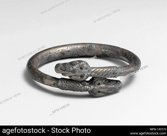Silver bracelet in the form of a snake. Period: Late Imperial; Date: 3rd century A.D; Culture: Roman; Medium: Silver; Dimensions: Diameter: 1 7/8 in