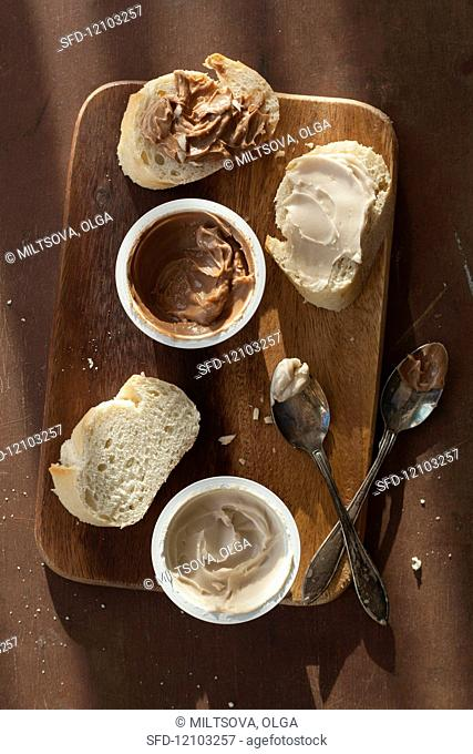 Vegan almond and coconut-almond spreads on bread and in bowls