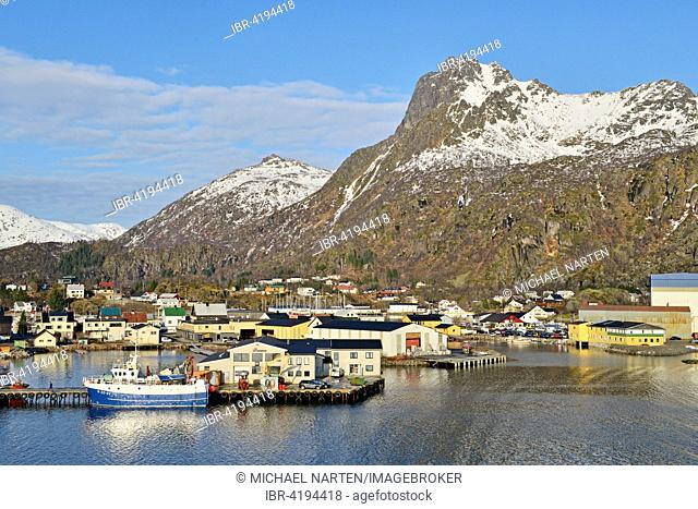 Harbor area with a boat in front of mountain scenery, snow, Svolvær, island Austvågøy, Lofoten, Nordland, Norway