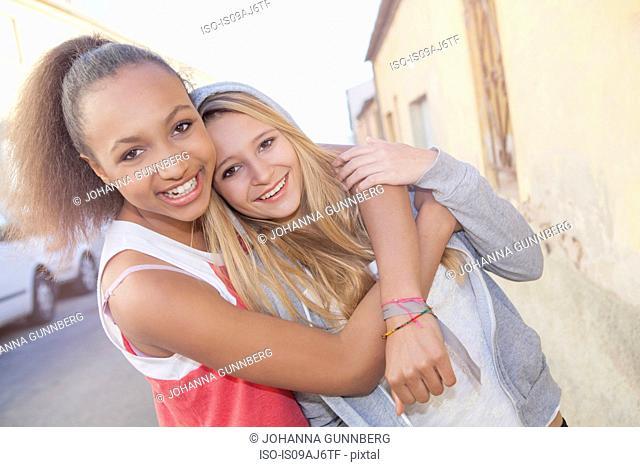 Teenage girls hugging
