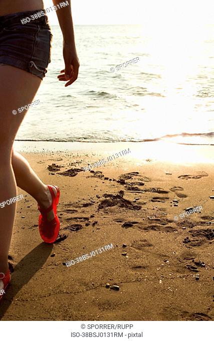Woman walking on beach