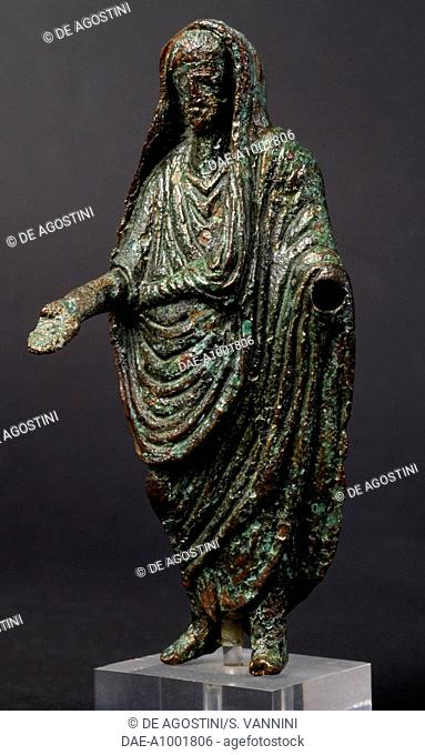 Male figure wearing a toga, bronze statuette. Etrusco-Roman civilisation.  Fiesole, Archaeological Museum