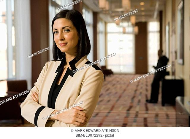 Mixed race businesswoman looking confident