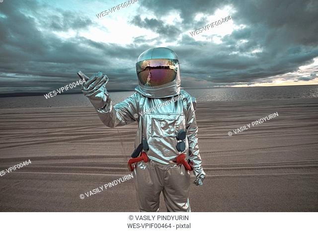 Spaceman pointing at something on a nameless planet
