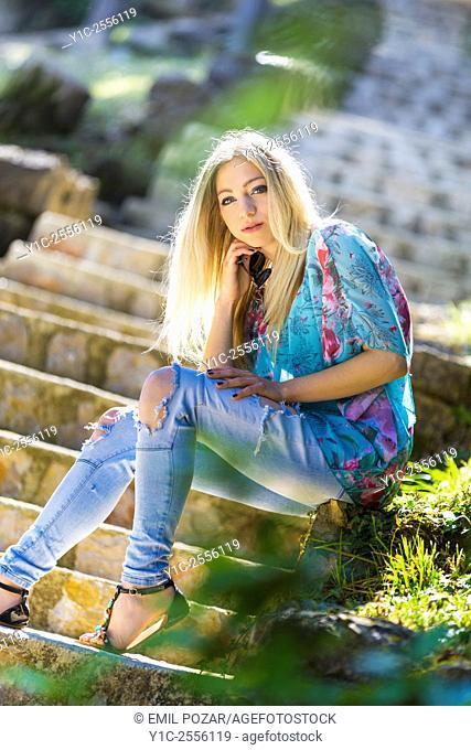 Stock Photo - Teen blonde on staircase sunnyday