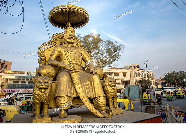 A gold statue of an Indian god is proudly displayed in downtown Agra. India