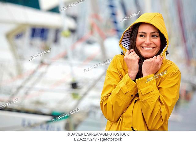 Woman with parka. Rain. Marina. Hendaye. Aquitaine. France