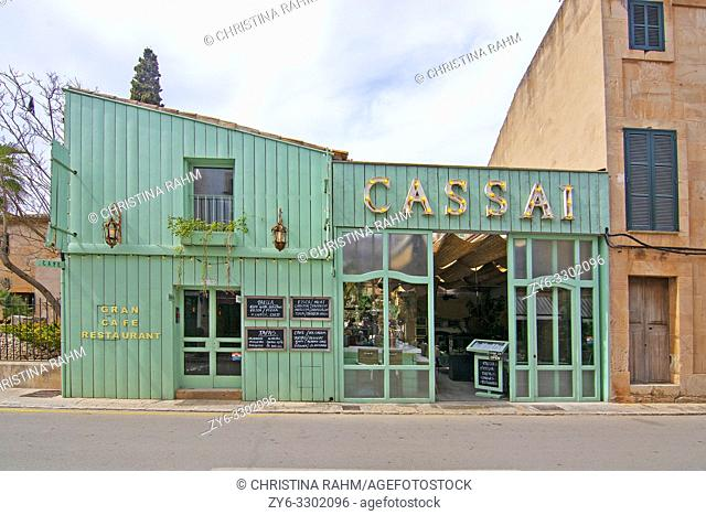 Cozy Bar and restaurant Cassai exterior street view and interior details in central city on an overcast day in Ses Salines, Mallorca, Spain