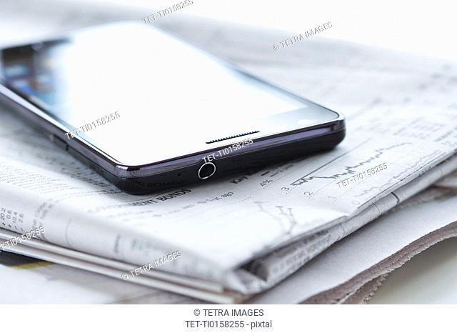 Smartphone on newspaper