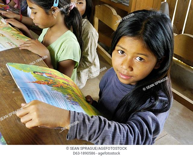 CAMBODIA. Projects of DPA in Stung Treng, supported by SCIAF. Katot village  Girls at the village literacy centre