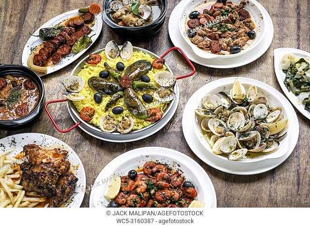 mixed portuguese traditional rustic tapas famous food selection on wood table