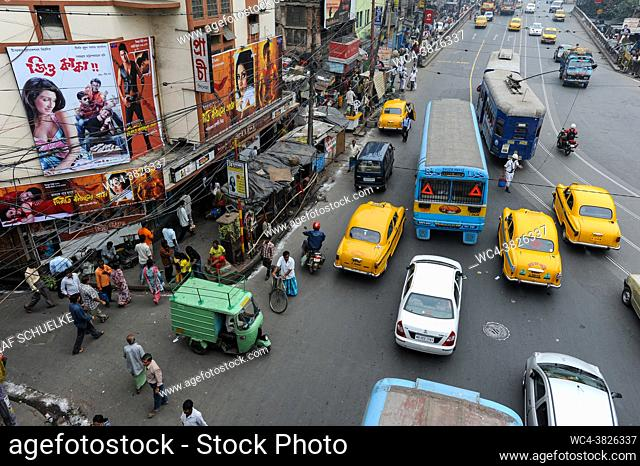 Kolkata (Calcutta), West Bengal, India, Asia - Elevated view showing an everyday street scene and traffic chaos with yellow Ambassador taxis in the Indian...