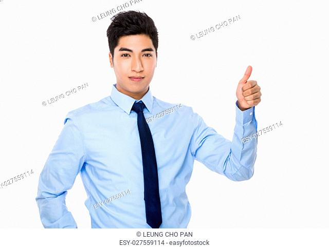 Young businessman with thumb up gesture