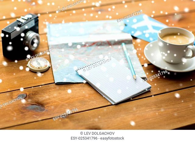 vacation, tourism, travel and objects concept - blank notepad with map, coffee and airplane tickets