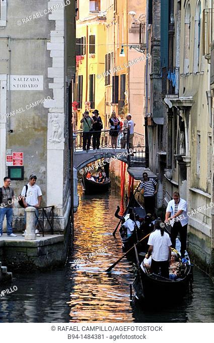 Gondolas in a canal, Venice, Veneto, Italy