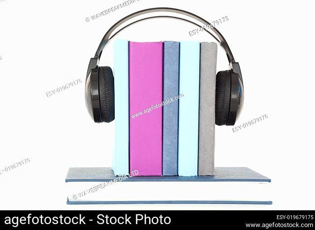 Headphones around books