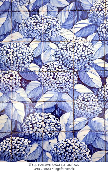 "Mural of portuguese blue glazed tiles, """"azulejo"""", with hydrangeas flowers. Vila Franca do Campo, Azores islands, Portugal"
