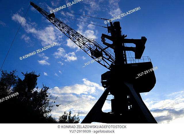 Silhouette of port crane over Yanov Backwater in Chernobyl Nuclear Power Plant Zone of Alienation around the nuclear reactor disaster in Ukraine