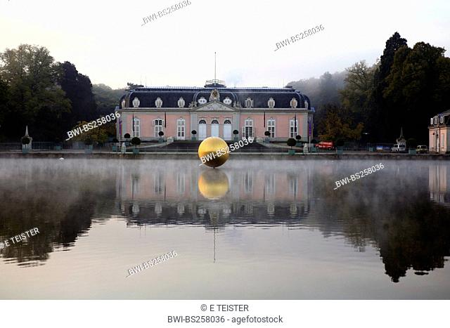 Benrath castle reflecting in a pond with golden bowl, Germany, North Rhine-Westphalia, Duesseldorf