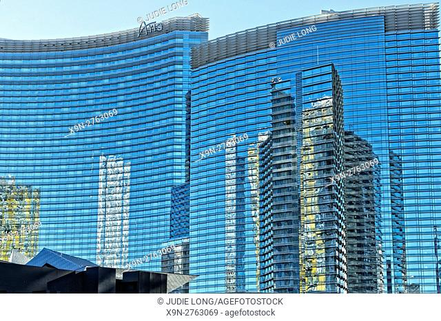 Las Vegas, NV, USA. The 'Strip.' Late Day Building Reflections in the Blue Glass facade of the Aria Hotel.
