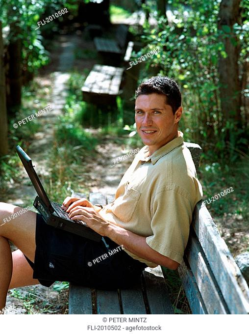 Fv4030, Peter Mintz; Man On Park Bench Using Laptop