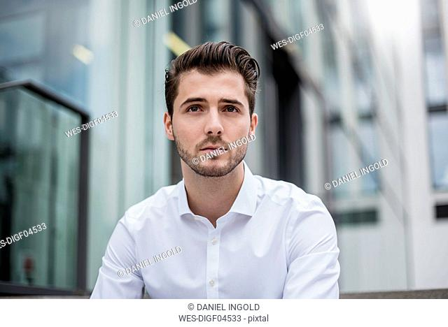 Portrait of young businessman in the city