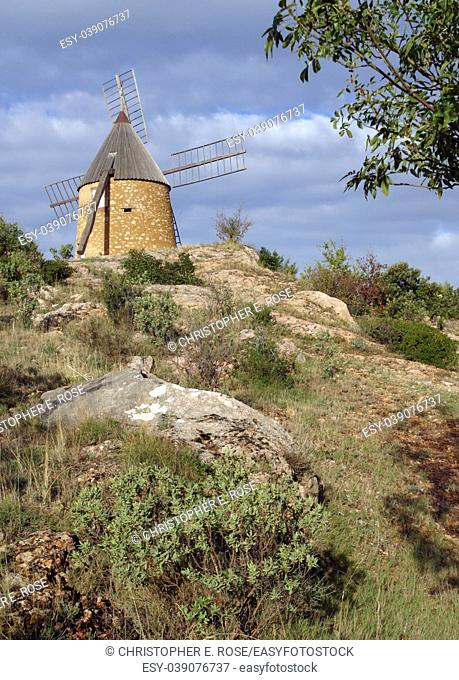 The restored windmill on the hill above St Chinian, Languedoc-Roussillon, France, Europe