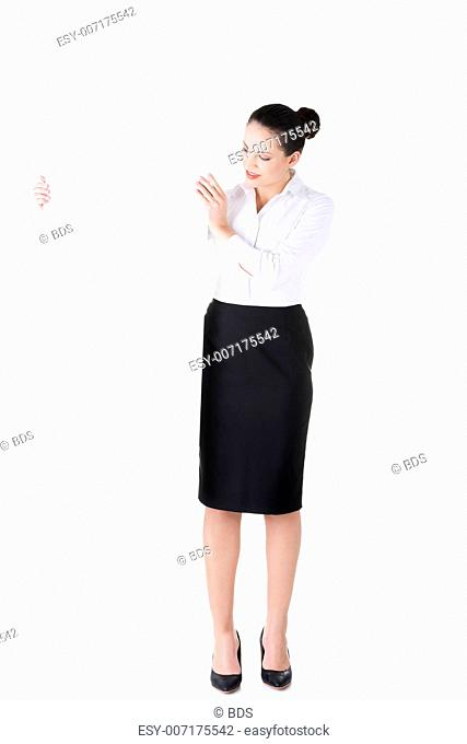 Attractive businesswoman holding blank board. Isolated on white