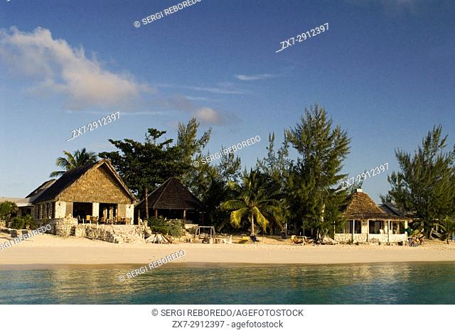 Cat Island, Bahamas. Beachfront cottages. Hotel Fernandez Bay Village resort. Tourists relaxing on the beach