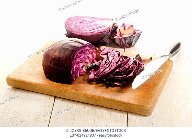 organic red cabbage prepared and sliced on a wooden board