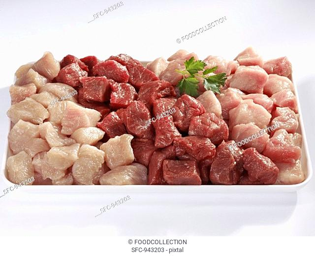 Diced beef, pork and turkey on a platter