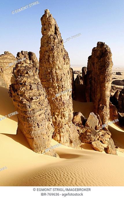 Cylindrical rock formations in Tin Akachaker, Tassili du Hoggar, Wilaya Tamanrasset, Sahara Desert, Algeria, North Africa