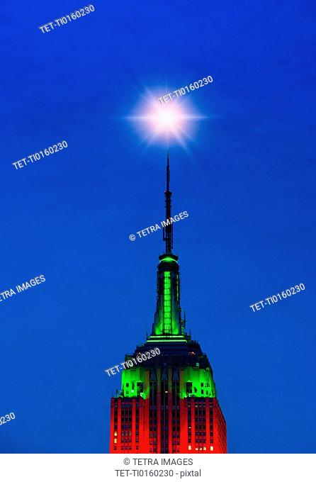 Empire State Building illuminated in red and green