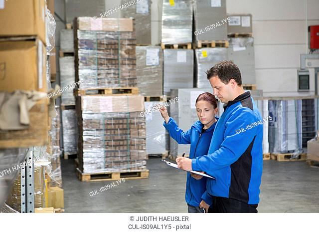Factory workers checking pallets