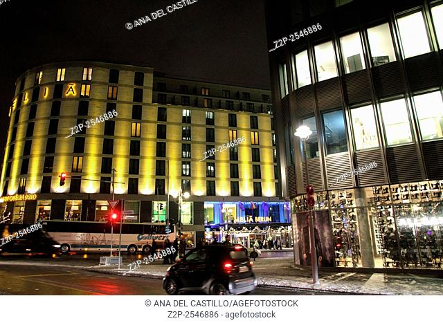 BERLIN GERMANY-DECEMBER 6: Night scene in Berlin on Christmas time on Dec 6, 2012 in Berlin. Melia hotel in background