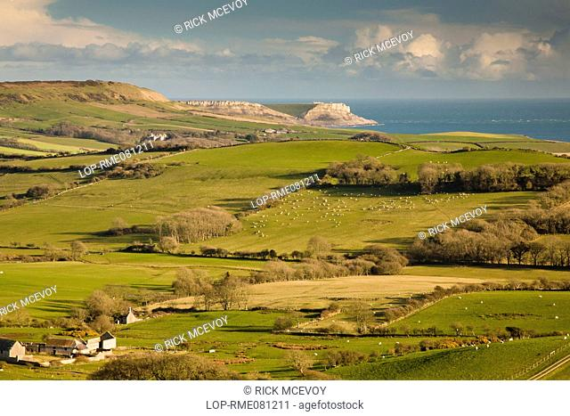England, Dorset, near Church Knowle. View from the Purbeck Hills near Church Knowle over rural pastures towards the coast and cliffs of the Jurassic Coast